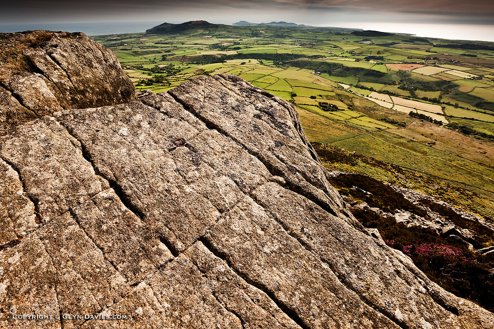 View from Carn Fadryn an Iron Age settlement on the highest point of the Llyn Peninsula at the tip of North West Wales. The Irish Sea can be seen surrounding this narrow, rural, farmland peninsula.