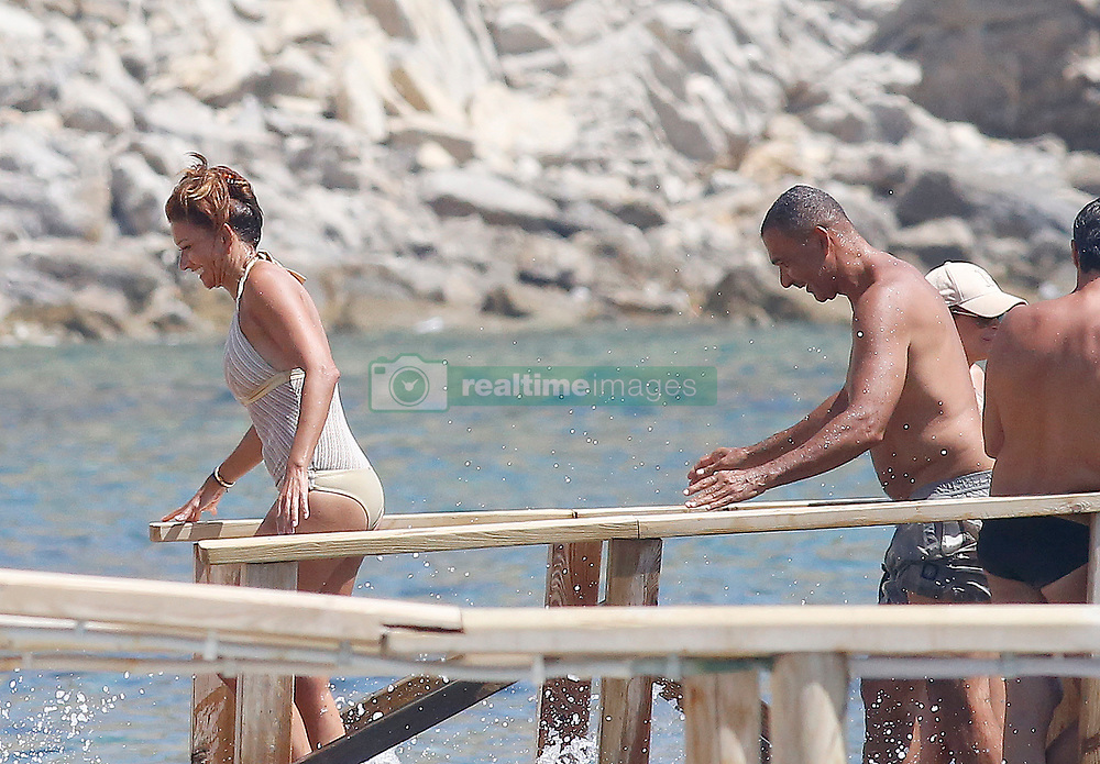 EXCLUSIVE: Ruud Gullit in bathing suit and his wife Maggie Jimenez in bikini are seen on the beaches of Ibiza while they enjoy their holidays in Ibiza on July 22, 2017 in Ibiza, Spain. 22 Jul 2017 Pictured: Ruud Gullit and Maggie Jimenez. Photo credit: Elkin Cabarcas / MEGA TheMegaAgency.com +1 888 505 6342