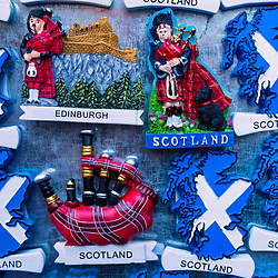 Tourist fridge magnets with Scottish motifs for sale in tourist souvenir shop in Edinburgh, Scotland, United Kingdom.