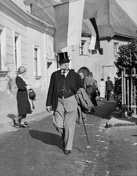 Man with Top Hat Walking in Street, Grinzing, Austria, circa 1933