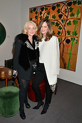 Left to right, AMANDA ELIASCH and TRINNY WOODALL at a private view of Made in Britain featuring contents from The Ivy sold to benefit Child Bereavement UK held at Sotheby's, 34-35 New Bond Street, London on 23rd March 2015.