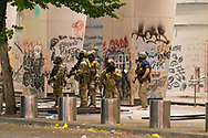 Unidentified Federal Militia on the sidewalk of the Federal courthouse in downtown Portland, Oregon
