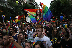 June 17, 2017 - Thessaloniki, Greece - People carry placards, flags and balloons during the 6th annual Gay Pride march in Thessaloniki, northern Greece, on June 17, 2017. (Credit Image: © Grigoris Siamidis/NurPhoto via ZUMA Press)