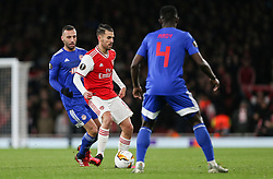 Dani Ceballos of Arsenal passes the ball under pressure - Mandatory by-line: Arron Gent/JMP - 27/02/2020 - FOOTBALL - Emirates Stadium - London, England - Arsenal v Olympiacos - UEFA Europa League Round of 32 second leg