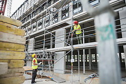 Construction workers at building site, Munich, Bavaria, Germany