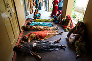 10th August 2011, Jhunjhunu.Women lie recovering from anaesthesia in an open-sided corridor after their sterilisation operation in a 'Sterilisation Camp' set up at, Jhunjhunu Health Centre, Rajasthan, India.<br />