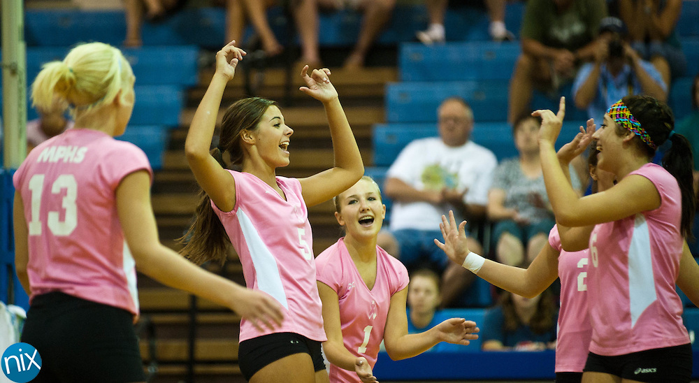 Mount Pleasant's Kendall Ross (5) celebrates with teammates Hannah Wichman (13) Darrian Bolt (1) Kathryn Eudy (2) and Victoria Jurado (6) after scoring a point against Albemarle Monday night at Mount Pleasant High School. The Tigers won the match  in three sets.  (photo by James NIx)