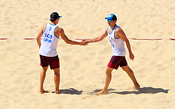 Scotland's Seain Cook (left) and Robin Miedzybrodzki during the Men's Preliminary - Pool B Beach Volleyball match against Sri Lanka at Coolangatta Beachfront during day two of the 2018 Commonwealth Games in the Gold Coast, Australia.