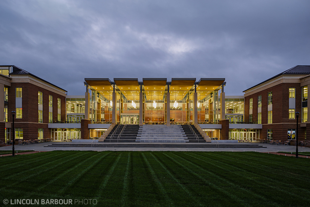 Looking straight on at the Liberty Student Center at dusk as it glows from the inside.