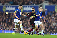 Gareth Barry of Everton (l) gets to the ball while David Silva of Manchester City (c) and Tom Davies of Everton look on. Premier league match, Everton v Manchester City at Goodison Park in Liverpool, Merseyside on Sunday 15th January 2017.<br /> pic by Chris Stading, Andrew Orchard sports photography.