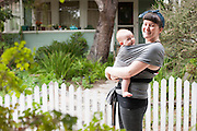 A mother wears her son while they both laugh during their outdoor family photography session, Venice, California, 2014.
