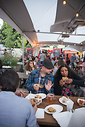 The Tidbit Food Pod on SE Division Street in Portland, Oregon has a large beer garden and 22 food carts.
