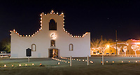 Scoorro Mission with luminarias on Christmas Eve, on the Mission Trail, Socorro, Texas.