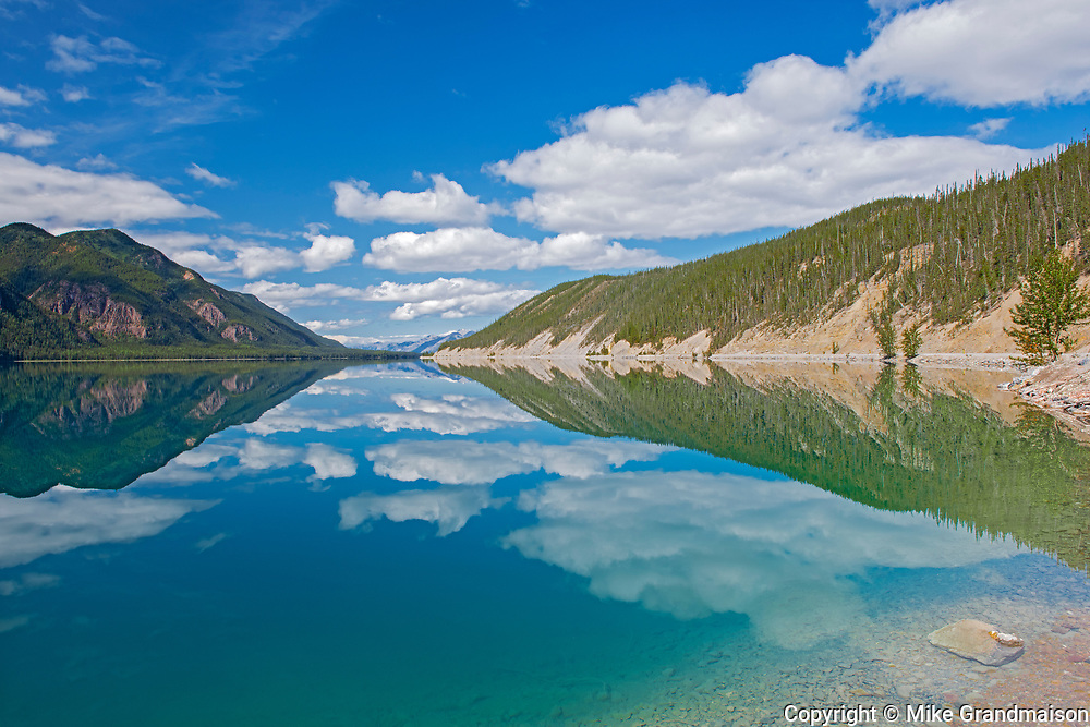 Muncho Lake reflection and the Northern Canadian Rockies<br />