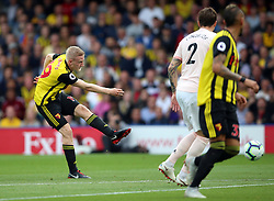 Watford's Will Hughes (left) shots towards goal during the Premier League match at Vicarage Road, Watford