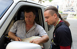Taxi driver giving instructions to journalist Rok Plestenjak in Warsaw centre on June 12, 2012 in Warsaw, Poland.  (Photo by Vid Ponikvar / Sportida.com)