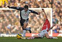 Photo: Leigh Quinnell.<br /> Tottenham Hotspur v Charlton Athletic. The Barclays Premiership. 05/02/2006. Charltons Alexei Smertin chalenges Tottenhams Aaron Lennon.
