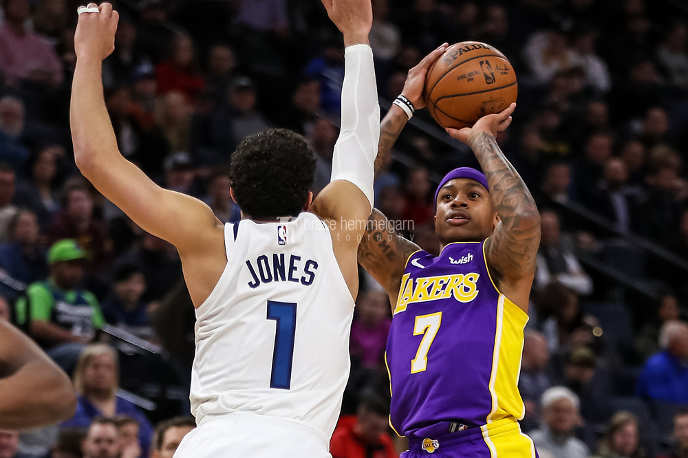 Feb 15, 2018; Minneapolis, MN, USA; Los Angeles Lakers guard Isaiah Thomas (7) shoots over Minnesota Timberwolves guard Tyus Jones (1) during the second quarter at Target Center. Mandatory Credit: Brace Hemmelgarn-USA TODAY Sports