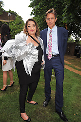 ZAHA HADID and ANDY BURNHAM MP minister of Culture, Media and Sport at the annual Serpentine Gallery Summer Party sponsored by Canvas TV  the new global arts TV network, held at the Serpentine Gallery, Kensington Gardens, London on 9th July 2009.