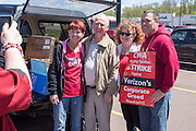 Pennsylvania State Representative David Millard (center) poses with striking Verizon workers near Bloomsburg. Millard brought food and water for striking families on Mother's Day.