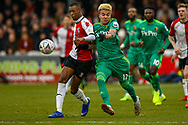 Watford forward Adalberto Peñaranda (17) challenged by Woking defender Nathan Collier (2) during the The FA Cup 3rd round match between Woking and Watford at the Kingfield Stadium, Woking, United Kingdom on 6 January 2019.