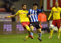 Watford's Gianni Munari challenges Wigan's Kim Bo-Kyung - Photo mandatory by-line: Richard Martin-Roberts/JMP - Mobile: 07966 386802 - 17/03/2015 - SPORT - Football - Wigan - DW Stadium - Wigan Athletic  v Watford - Sky Bet Championship