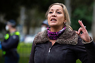 A member of the public begs the police to show compassion for the residents stuck inside of 120 Racecourse Road amid the third full day of the total lockdown of 9 housing commission high rise towers in North Melbourne and Flemington during COVID 19.After recording 191 COVID-19 cases overnight forcing Premier Daniel Andrews to announce today that all of metropolitan Melbourne along with one regional centre, Mitchell Shire will once more go back to stage three lockdowns from midnight Wednesday June 8. This comes as the residents of the housing commission towers in North Melbourne and Flemington finish their third day under extreme lockdown, despite only 27 cases being found in the towers. Members of the public gathered outside of the towers this afternoon in support of those trapped inside while riot police arrested two women for standing too close to the fence. While the women were later released, tensions are boiling over both in the towers and out. With 772 active cases in Victoria, NSW closed their border to Victoria effective at midnight tonight.