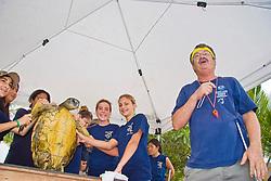 Researcher George Balazs PhD, educating public bystandards entertainingly on Sea Turtle Research, organized by NOAA National Marine Fisheries Service (NMFS), Hawaii Preparatory Academy (HPA) students and teachers (NOAA/HPA Marine Turtle Program), and ReefTeach volunteers at Kaloko-Honokohau National Historical Park, Kona Coast, Big Island, Hawaii, USA, Pacific Ocean