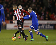 Leon Clarke of Sheffield Utd tussles with Brian Wilson of Oldham during the English League One match at Bramall Lane Stadium, Sheffield. Picture date: December 26th, 2016. Pic Simon Bellis/Sportimage
