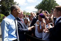 President Barack Obama and former President Bill Clinton greet audience members following the 20th anniversary of the AmeriCorps national service program on the South Lawn of the White House, Sept. 12, 2014. (Official White House Photo by Pete Souza)<br /> <br /> This official White House photograph is being made available only for publication by news organizations and/or for personal use printing by the subject(s) of the photograph. The photograph may not be manipulated in any way and may not be used in commercial or political materials, advertisements, emails, products, promotions that in any way suggests approval or endorsement of the President, the First Family, or the White House.