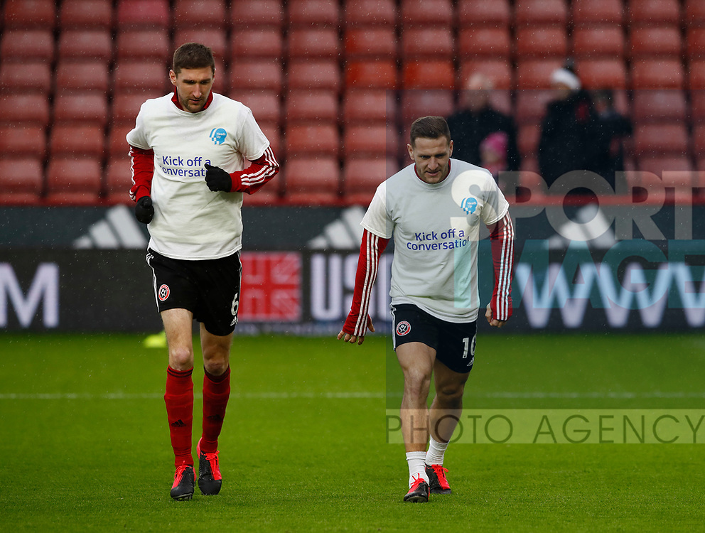 Chris Basham of Sheffield Utd and Billy Sharp of Sheffield Utd during the Premier League match at Bramall Lane, Sheffield. Picture date: 9th February 2020. Picture credit should read: Simon Bellis/Sportimage