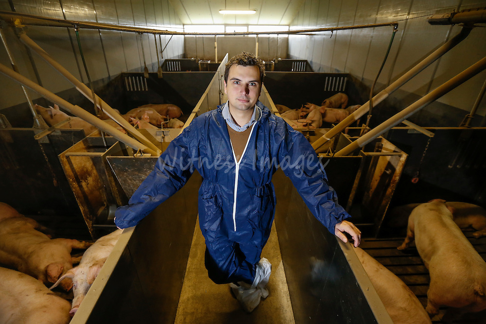 """Stijn Bossin from the Innovation Centre for Agricultural and Rural Development during the DG AGRI Study trip to Belgium """"The CAP and Innovation"""". Visit of Alfons Gios' pig farm in Herenthout November 27, 2013.  Photo : Thierry Roge © European Union"""