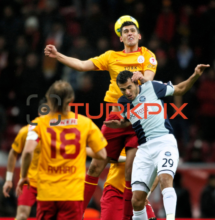 AdanaDemirspor's Burhan Coskun (R) during their Turkey Cup matchday 3 soccer match Galatasaray between AdanaDemirspor at the Turk Telekom Arena at Aslantepe in Istanbul Turkey on Tuesday 10 January 2012. Photo by TURKPIX