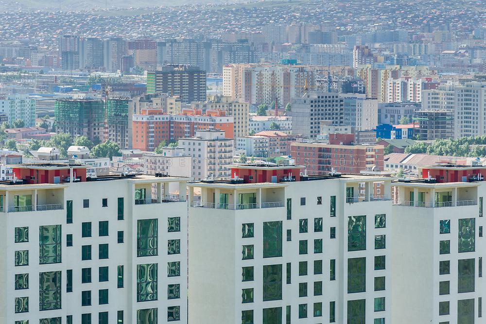 Modern high rise buildings in Ulaanbaatar, Mongolia, with a view of the ger districts in the background. Photo © Robert van Sluis - www.robertvansluis.com