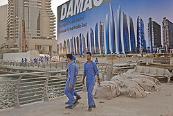 Workers leaving a construction site in Dubai