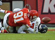 KANSAS CITY, MO - OCTOBER 20:  Quarterback Case Keenum #7 of the Houston Texans fumbles as he is sacked by linebacker Tamba Hali #91 of the Kansas City Chiefs during the fourth quarter on October 20, 2013 at Arrowhead Stadium in Kansas City, Missouri.  (Photo by Peter Aiken/Getty Images) *** Local Caption *** Case Keenum;Tamba Hali
