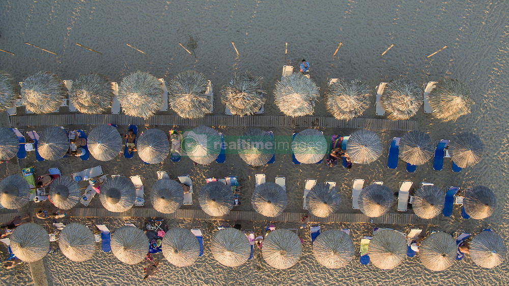 August 4, 2017 - Nea Irakleia, Greece - Aerial shots of Nea Irakleia, a long sandy beach destination with crystal clear and calm water, warm sea as it is in Themaikos gulf. This beach is about 20 minutes driving away from LGTS/SKG Thessaloniki airport or  about 40 minutes from the city center. The past years many new beach bars appeared in the area. (Credit Image: © Nicolas Economou/NurPhoto via ZUMA Press)