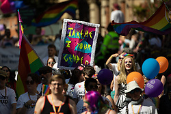 "© Licensed to London News Pictures . 24/08/2019. Manchester, UK. "" Take me to your gender "" placard . The 2019 Manchester Gay Pride parade through the city centre , with a Space and Science Fiction theme . Manchester's Gay Pride festival , which is the largest of its type in Europe , celebrates LGBTQ+ life . Photo credit: Joel Goodman/LNP"
