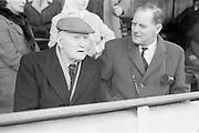 11/04/1964<br /> 04/11/1964<br /> 11 April 1964<br /> Irish Senior Hockey Cup Final, Three Rock Rovers v Church of Ireland (Cork) at Londonbridge Road, Dublin. T.S.C. Dagg, President Three Rock Rovers and Noel Dagg (nephew) ex-Captain of Three Rock Rovers, watch Rovers defeat the Church of Ireland (Cork) Hockey team.