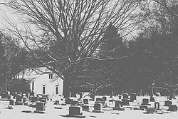 23 February 2008: Funks Grove Church stands behind the adjoining cemetery which is covered by a winters snow.<br /> <br /> This image was produced in part utilizing High Dynamic Range (HDR) or panoramic stitching or other computer software manipulation processes. It should not be used editorially without being listed as an illustration or with a disclaimer. It may or may not be an accurate representation of the scene as originally photographed and the finished image is the creation of the photographer.