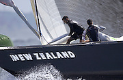 Jeremy Lomas and Matt Mitchel set up for a spinnaker set on NZL 82 as they round the top mark in race three of the America's Cup 2003. 18/2/2003 (© Chris Cameron 2003)