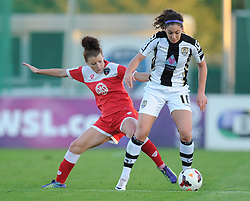 Bristol Academy Womens' Jemma Rose tries to tackle Notts County Fiona O'Sullivan - Photo mandatory by-line: Alex James/JMP - Mobile: 07966 386802 - 04/10/2014 - SPORT - Football - Bristol - Stoke Gifford Stadium - Bristol Academy Womens v Notts County Ladies - Womens Super League