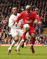 Photo. Jed Wee<br />Liverpool v Middlesbrough, FA Barclaycard Premiership, Anfield, Liverpool. 08/02/2003.<br />Liverpool's El Hadji Diouf (R) shows good control with Middlesbrough's David Murphy in close attendance.