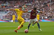 Kieran Richardson of Aston Villa and Emre Can of Liverpool compete for the ball.  The FA Cup, semi final match, Aston Villa v Liverpool at Wembley Stadium in London on Sunday 19th April 2015.<br /> pic by John Patrick Fletcher, Andrew Orchard sports photography.