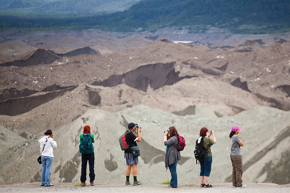 Tourists line up to take pictures of the moraines at the toe of the Kennicott Glacier in Wrangell-St. Elias National Park, Alaska.