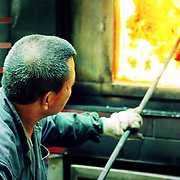 Burning paper offerings furnace, Hong Kong, China (January 2006)