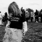 Gwenyth Tackett, 4, of Marina, Calif. holds a sign during the Women's March at California State University Monterey Bay on Jan. 20, 2017.