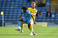 Coventry City defender Junior Brown (12) holds up the ball under pressure during the EFL Sky Bet League 1 match between Oxford United and Coventry City at the Kassam Stadium, Oxford, England on 9 September 2018.
