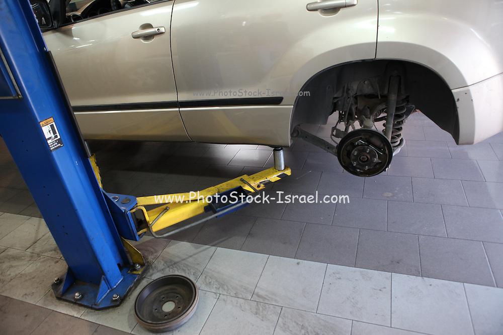 Car being serviced at a repair shop