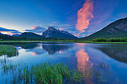 Cloud at dawn reflected in Vermillion Lakes with Mount Rundle .<br />